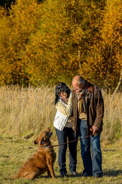 Couple training dog autumn sunset park Stock photo © CandyboxPhoto