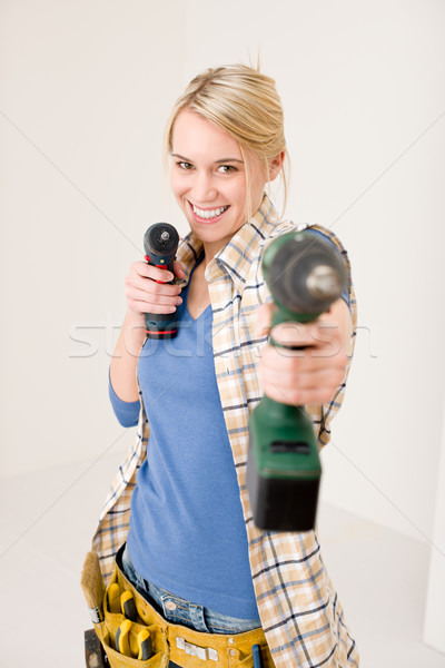 Home improvement - woman with battery screwdriver Stock photo © CandyboxPhoto