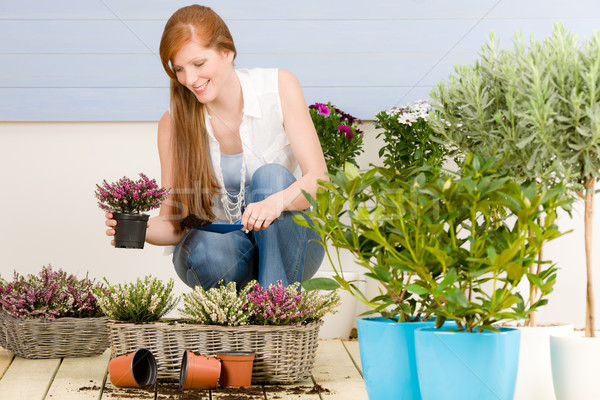 Summer garden terrace redhead woman with flowers Stock photo © CandyboxPhoto