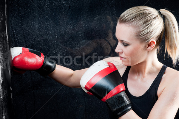 Boxing training woman in gym punching bag Stock photo © CandyboxPhoto