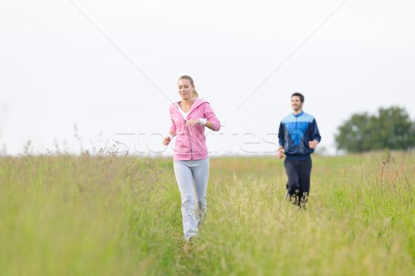 Jogging fiatal pér fut legelő mező fiatal Stock fotó © CandyboxPhoto