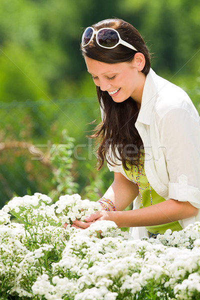 Summer garden beautiful woman care white flowers Stock photo © CandyboxPhoto