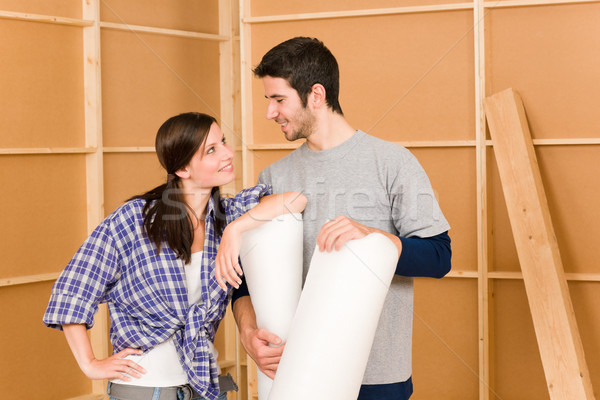 Stock photo: Home improvement young couple work on renovations