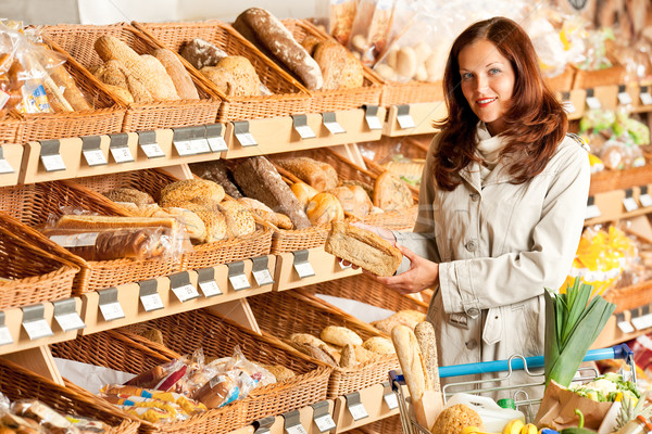 Grocery store: Young woman choosing bread Stock photo © CandyboxPhoto