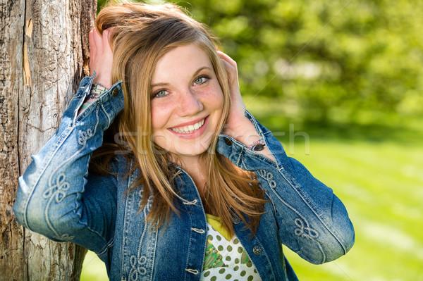 Overjoyed girl outside leaning to tree Stock photo © CandyboxPhoto