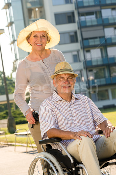 Wealthy senior man in wheelchair with wife Stock photo © CandyboxPhoto