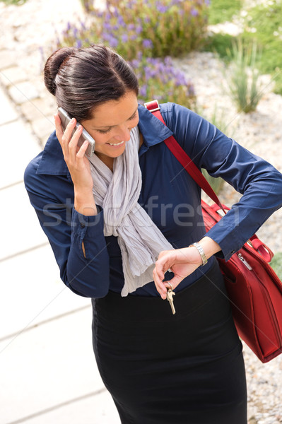 Woman calling rushing arriving home business phone Stock photo © CandyboxPhoto