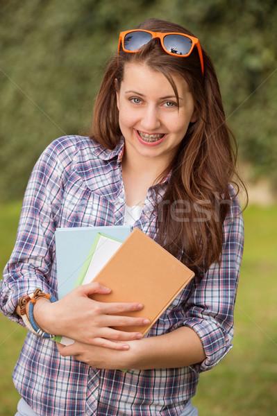 Boldog diák fogszabályozó tart könyvek kívül Stock fotó © CandyboxPhoto
