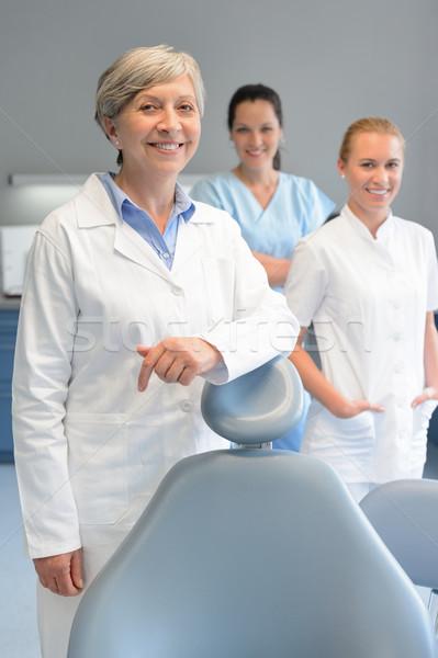 Profissional dentista equipe mulher cirurgia dentária três Foto stock © CandyboxPhoto