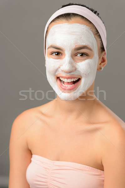Body care young woman facial mask smiling  Stock photo © CandyboxPhoto