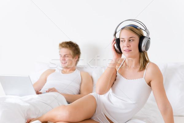 Fiatal pér pihen ágy zene laptop együtt Stock fotó © CandyboxPhoto