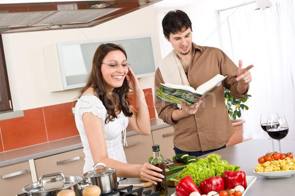 Szczęśliwy para gotować kuchnia książka kucharska wraz Zdjęcia stock © CandyboxPhoto