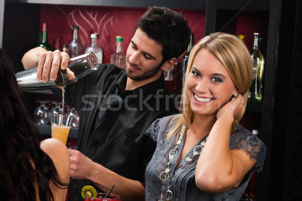 Attractive blond girl at cocktail bar smiling Stock photo © CandyboxPhoto