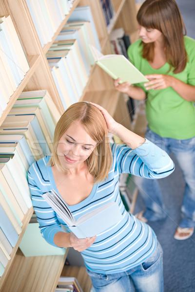 Stock fotó: Diák · könyvtár · kettő · boldog · nő · olvas
