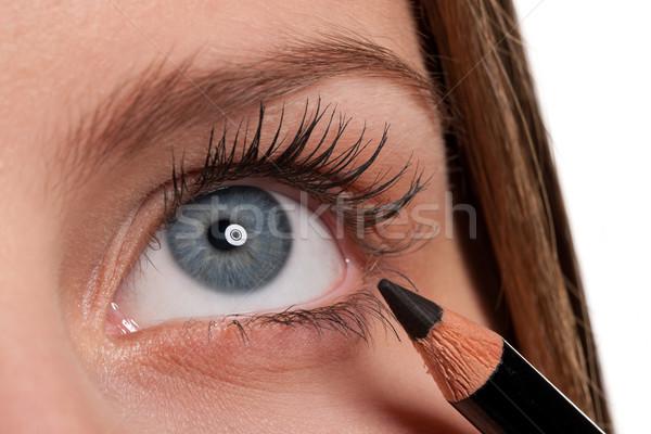 Blue eye, woman applying black make-up pencil Stock photo © CandyboxPhoto