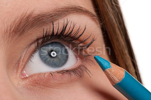 Blue eye, woman applying turqouise make-up pencil Stock photo © CandyboxPhoto