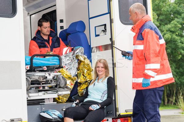 Woman in ambulance with paramedics aid accident Stock photo © CandyboxPhoto