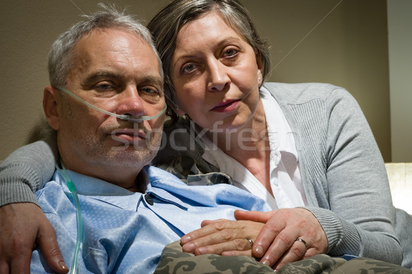 Anxious senior wife holding her sick husband Stock photo © CandyboxPhoto