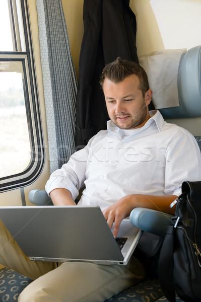 Homem sessão trem usando laptop computador pendulares Foto stock © CandyboxPhoto