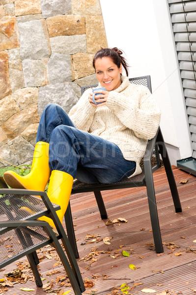 Cheerful woman drinking cocoa relaxing veranda autumn Stock photo © CandyboxPhoto