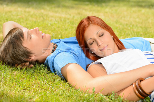 Teenage couple relaxing on grass closed eyes Stock photo © CandyboxPhoto