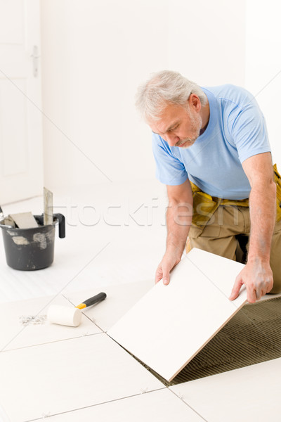 Home improvement - handyman laying ceramic tile  Stock photo © CandyboxPhoto