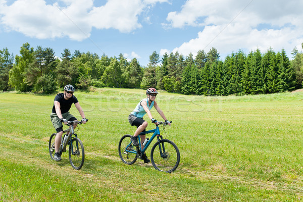 Sport happy couple riding bicycles in coutryside Stock photo © CandyboxPhoto