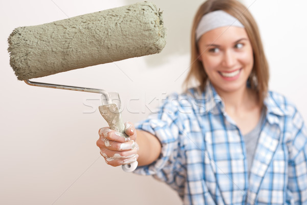 Home improvement: Young woman with paint roller  Stock photo © CandyboxPhoto