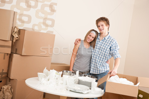 Moving house: Happy man and woman with box Stock photo © CandyboxPhoto