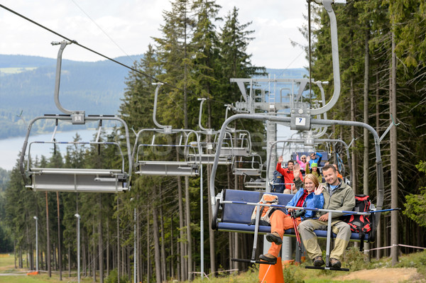 Waving young people sitting on chairlift Stock photo © CandyboxPhoto