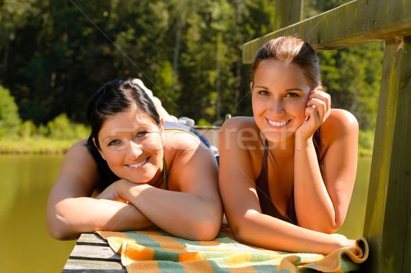 матери дочь солнечные ванны пирс улыбаясь подростков Сток-фото © CandyboxPhoto