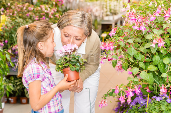 Garden center girl with grandmother smell flower Stock photo © CandyboxPhoto