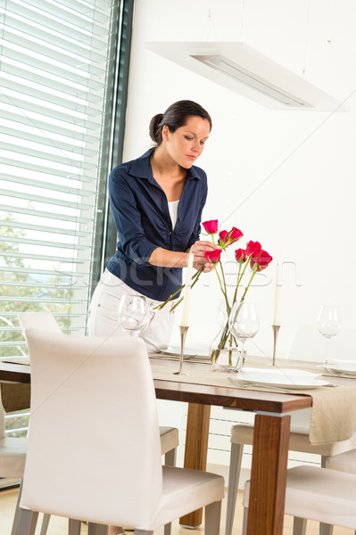 Woman decorating red roses dining room wife Stock photo © CandyboxPhoto