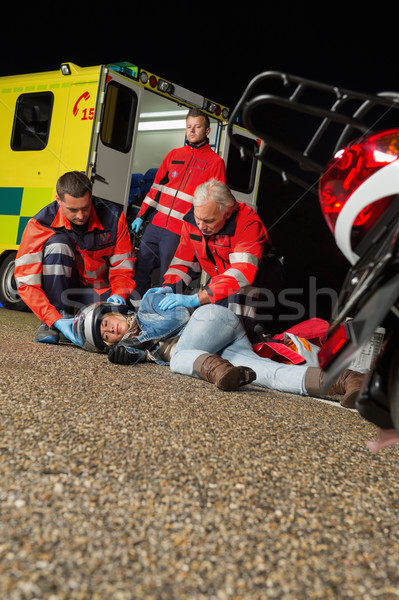 Emergency team helping injured motorbike driver Stock photo © CandyboxPhoto