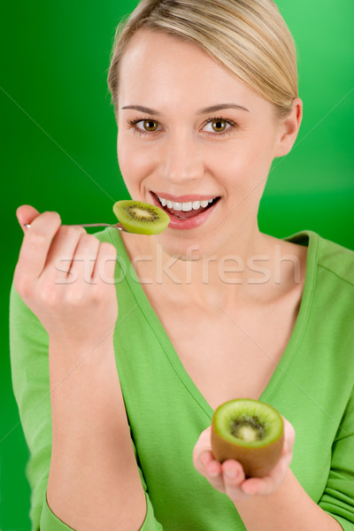 Healthy lifestyle - happy woman holding kiwi and teaspoon Stock photo © CandyboxPhoto