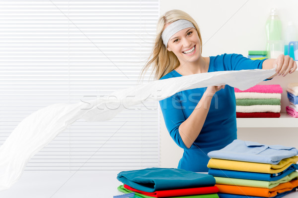 Laundry - woman folding clothes Stock photo © CandyboxPhoto