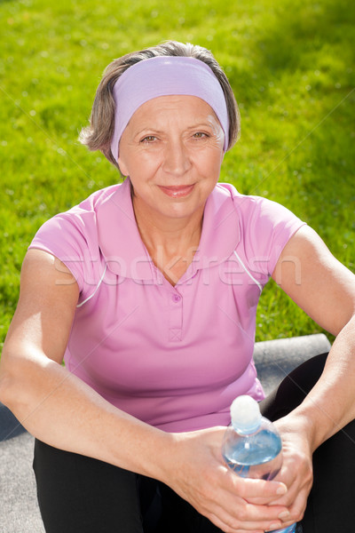 Senior sportive woman happy hold bottle water Stock photo © CandyboxPhoto
