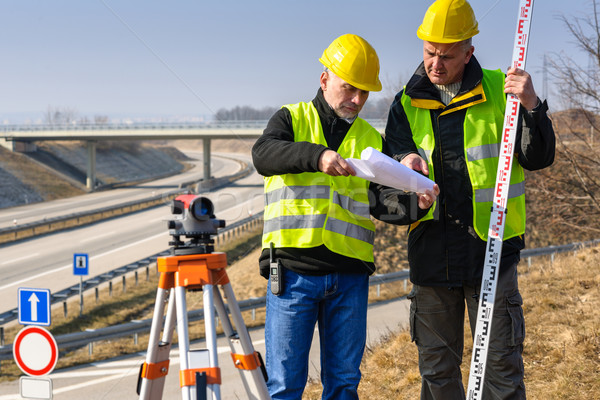 Geodesist read plans on construction site Stock photo © CandyboxPhoto