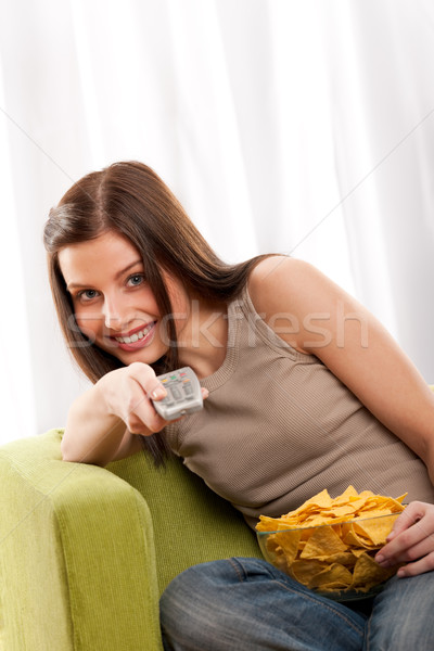 Students series - Smiling young woman watching television and ea Stock photo © CandyboxPhoto