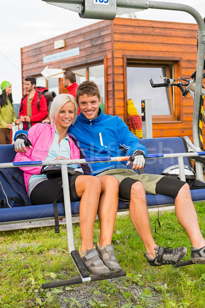 Smiling couple sitting and waiting on chair-lift Stock photo © CandyboxPhoto