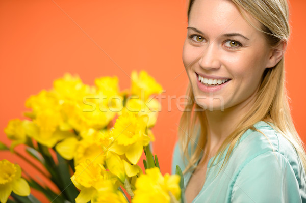 Smiling woman with spring yellow narcissus flowers Stock photo © CandyboxPhoto