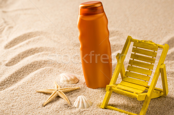 Suntan lotion container and seashells on sand  Stock photo © CandyboxPhoto