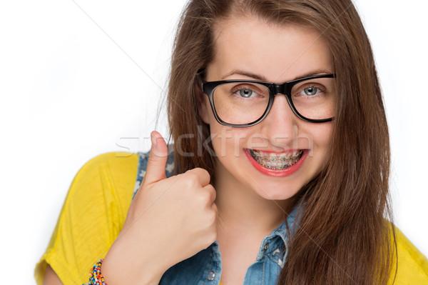 Nina tirantes mostrar pulgar hasta aislado Foto stock © CandyboxPhoto