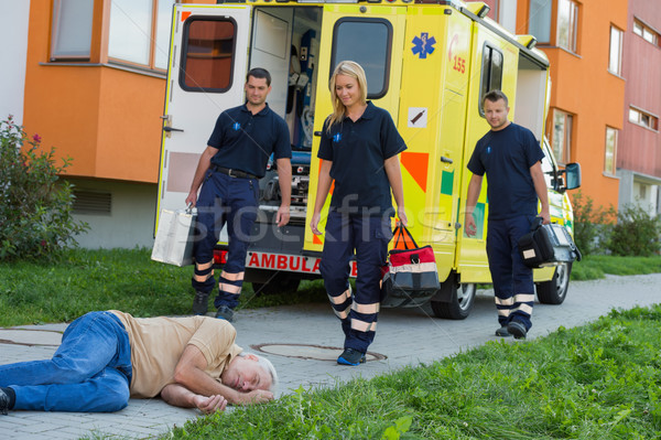 Paramedics arriving to unconscious man Stock photo © CandyboxPhoto