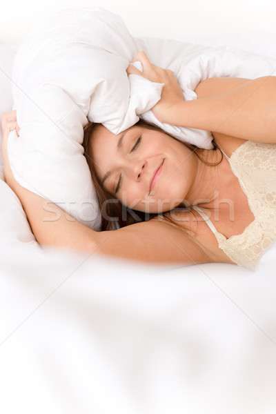Bedroom - lazy woman getting up blocking ears Stock photo © CandyboxPhoto