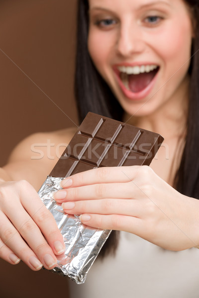 Chocolate - portrait young woman bite sweets Stock photo © CandyboxPhoto