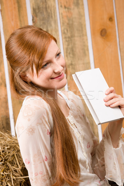 Young romantic woman hold book in barn Stock photo © CandyboxPhoto