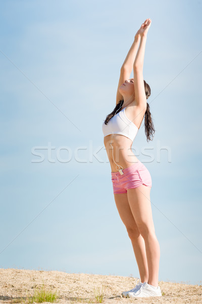 Summer sport fit woman stretching on beach Stock photo © CandyboxPhoto