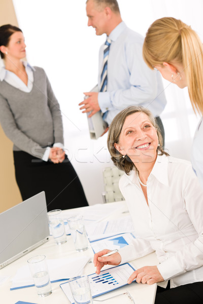 Sales meeting business people review reports Stock photo © CandyboxPhoto