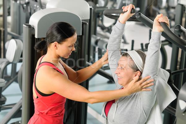 Senior woman exercise on shoulder press machine Stock photo © CandyboxPhoto